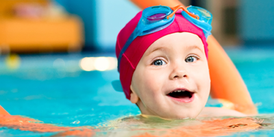 Child Swimming With Noodle